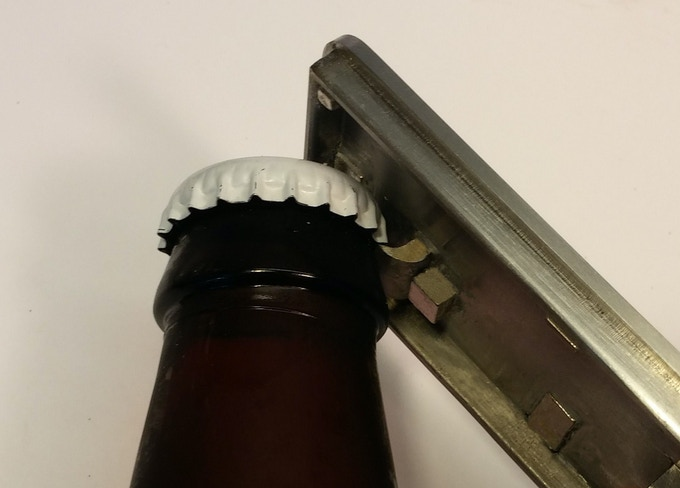 The cap serves as a bottle opener without removing the tools