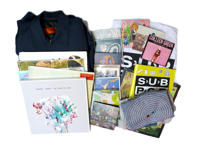 For $400: 16 pounds of goodness from our pals at Sub Pop, including nine CDs, 8 LPs, 4 T-shirts, a coloring book, a button pack, pencils, sunglasses, a mug, a jacket, and a tote.