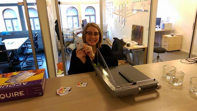 Here's Katie, our gifted wordsmith. Cutting our own cards to keep costs down.