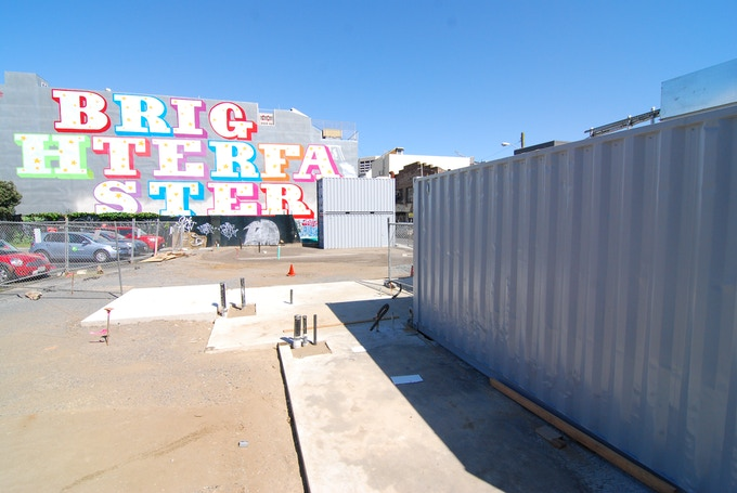 """""""BRIGHTER FASTER"""" by Ben Eine provides a colorful backdrop for construction. © Joseph Perez-Green 2011."""