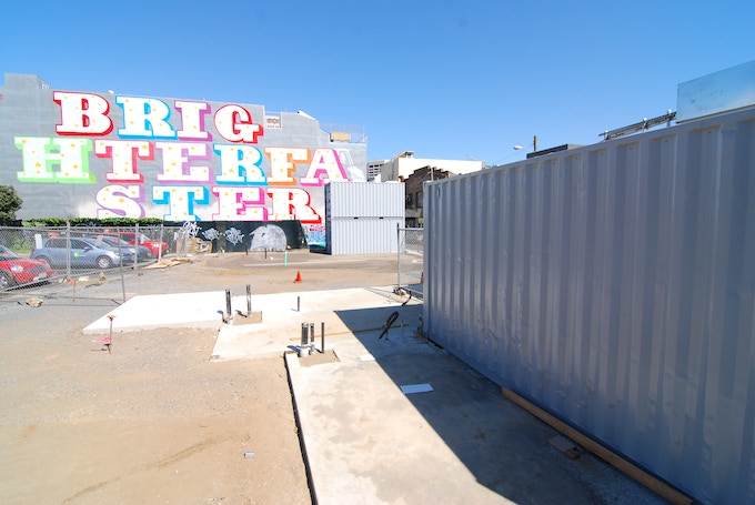 """BRIGHTER FASTER"" by Ben Eine provides a colorful backdrop for construction. © Joseph Perez-Green 2011."