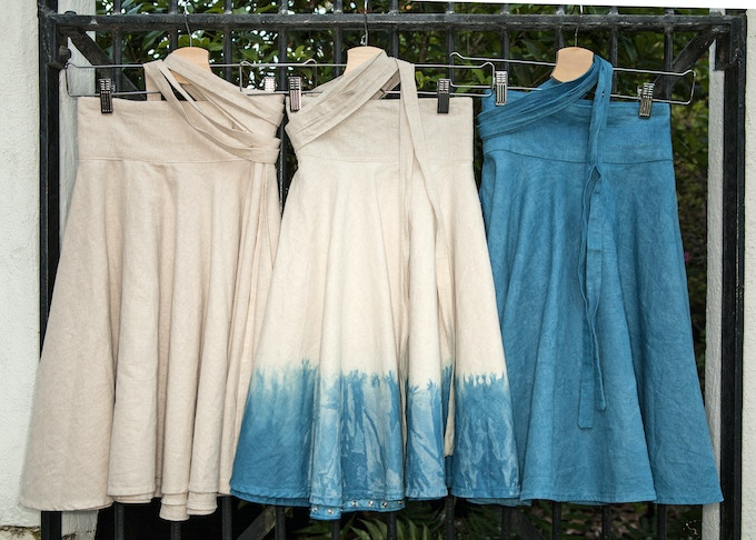 Bicycle Wrap Skirts shown in three available colorways: Natural (undyed), Dip Dye Indigo Blue, and Solid Indigo Blue (hand-dyed options are limited)