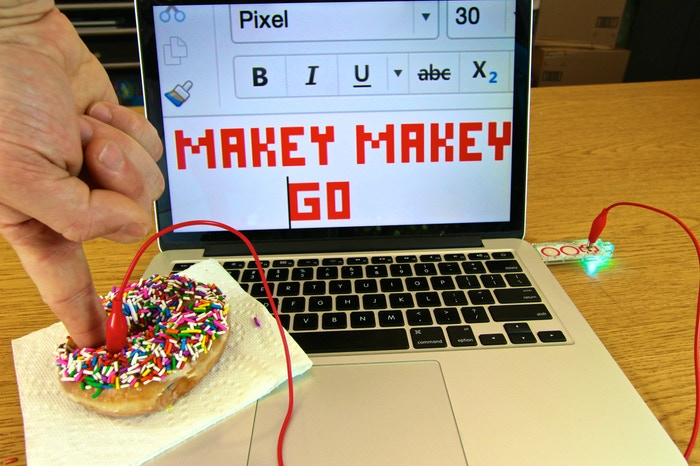 """In a Text Editor, Makey Makey GO pushes """"space"""" every time you touch the donut"""