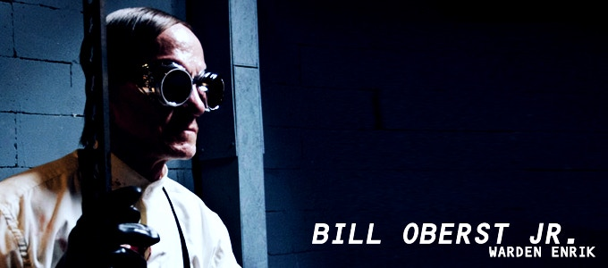 Bill Oberst Jr. (Criminal Minds, The Retrieval) electrifies as the sadistic and calculating WARDEN ENRIK