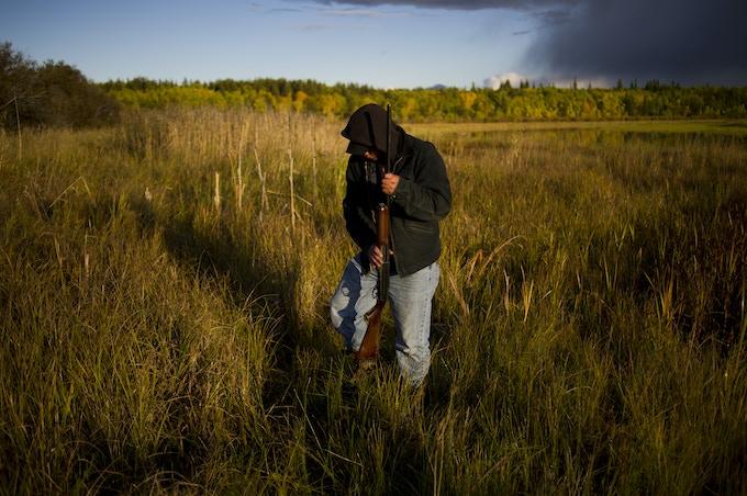 Métis Hunter at Big Point, Fort Chipewyan, Alberta (2010). Ian Willms. 8x12 Chromogenic Print.