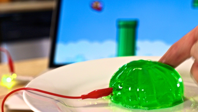 "Give new meaning to ""Play with your Food."" Grab some jello out of the fridge, and grab your Makey Makey GO off the fridge door (it's a magnet!). Play a video game by slapping jello."