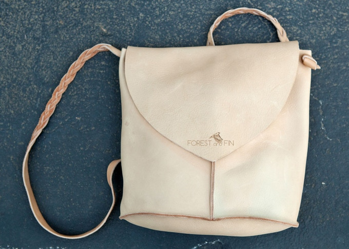 Leather backpack with hand-braided straps and flap closure by Waypost Craft created for Forest and Fin's Bicycle Wrap Skirt.