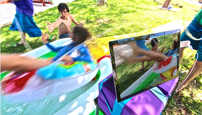A High-Five triggers a selfie photo on a tablet as you launch off the ramp into the water