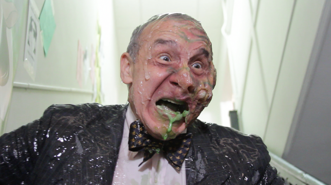 The evil CEO Herzkauf, played by director Lloyd Kaufman, finds his body mutated by the very pollutants he sought to spread!