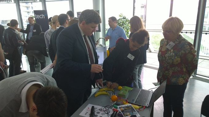 A 'skilled up' young person teaching Deputy Mayor Kit Malthouse about Tech @ the launch of London Tech Week 2014