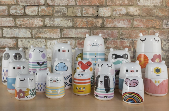 The whole Kickstarter gang of fine china storage jar characters.
