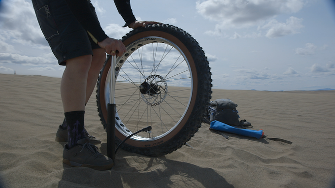 Inflate a fat tire in half of the strokes of a conventional mini pump.