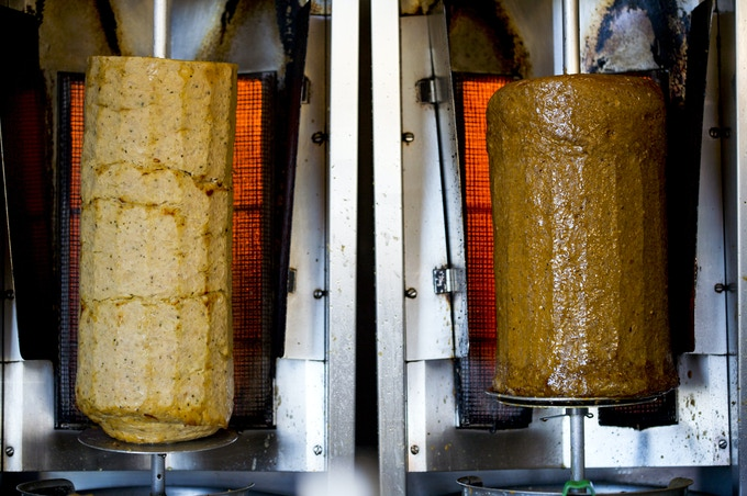 Our chicken and beef & lamb döner meat roasting on the vertical broilers, aka spits.