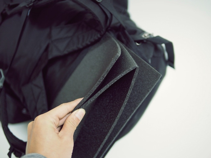 Removable backpad unfolds into sleeping pad
