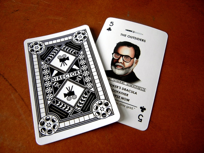 The backs of the cards feature a detailed black & white design.