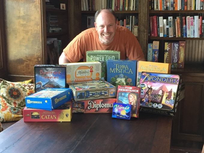 Alex with some of his favorite games