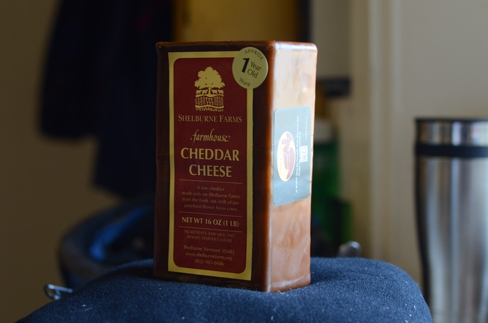 We bought close to 2 full days of production of  Shelburne Farm's cheddar. The cheese has been cut and waxed, and will be shipped this week.