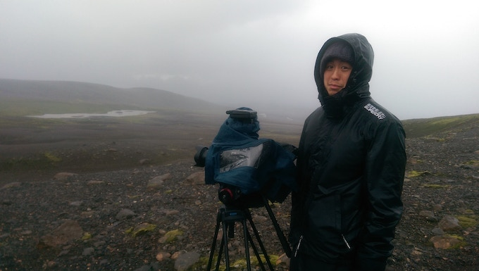 Our man Johnny Ho in action – soaking wet but still filming.