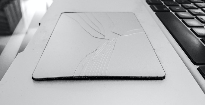 The MacBook Pro's battery is bulging and causing the trackpad to pop out and crack.