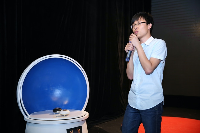 Engineer demonstrating the functions of LoveLinkU robot.