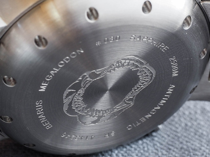 Megalodon jaws engraved on the case back