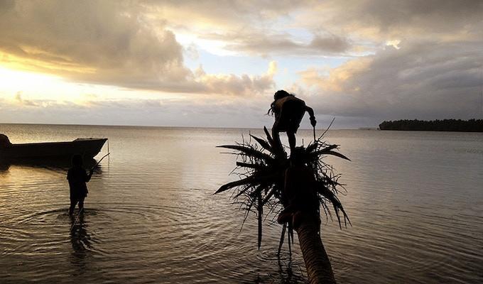 Kids fishing on Motu Ko.
