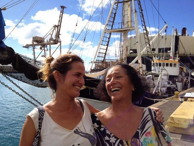 Amelia Borofsky and Johnny Frisbie with the KWAI at Honolulu Harbor.