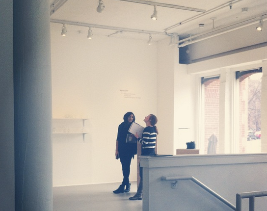 Tamara and Andrea discussing the logistics of presenting in The Mills Gallery.