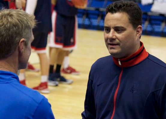 Arizona head coach Sean Miller (right) talks to Steve Kerr before coaching the Wildcats to victory in the 2014 Sweet Sixteen. Photo by Brad Malone.