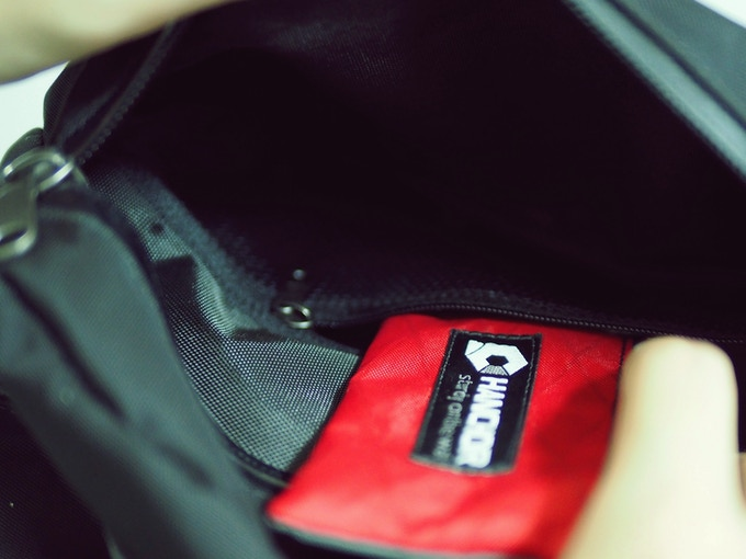A mesh pocket in the top compartment is easy to access and keeps small items organized.