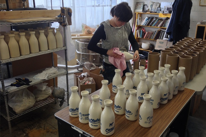 "Professional artist assistant Laurie Trok shipping bottles from Farm No. 002 (""Valley Farm"") in 2014."