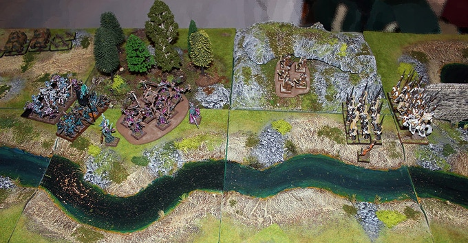 Snapshot of Pedion demo board in UKGE2015; High Elves battle Dark Elves in 28mm, while 15mm Flames of War tanks make their appearance on the upper left