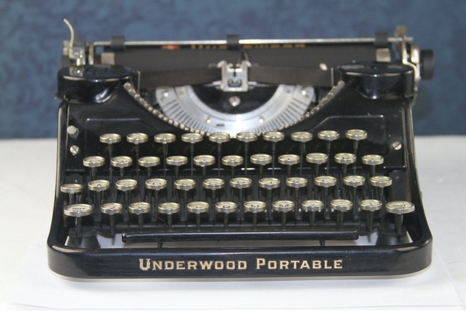 "Help us get the words ""Blunderwood Portable"" in giant gold (or fake gold) leaf on the front of our typewriter!"