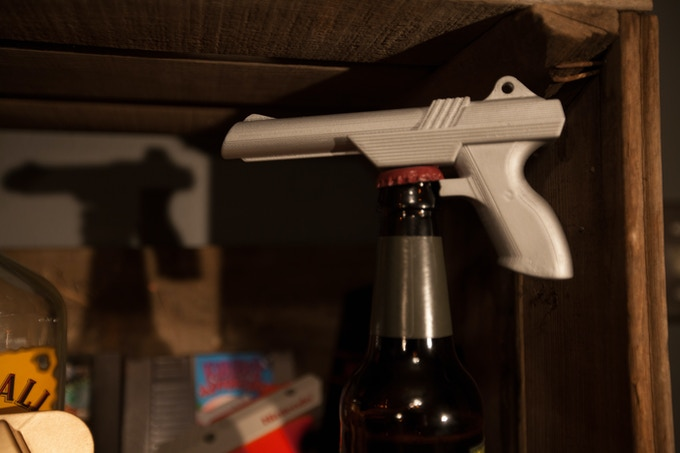 No dodgy ducks, no giggling dogs...Just you, a cold beer, and a trusty childhood friend held firmly in hand. THE GUN! The bottle opener gun. Nothing else. You get it. Youuu get it.