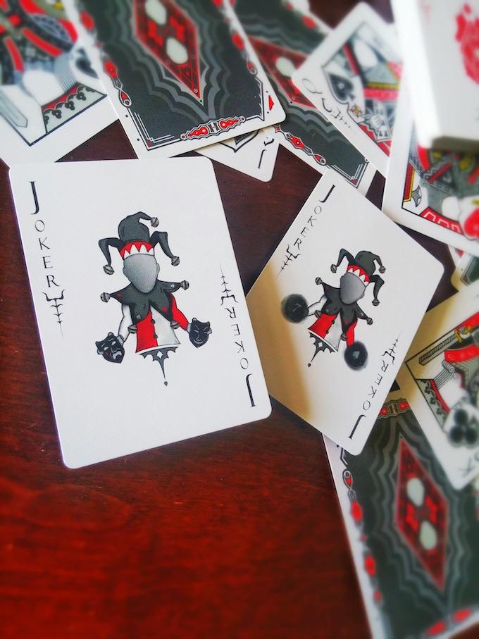 LEFT: Joker #1 Holding Two Masks RIGHT: Joker #2 Masks have Dissipated - Seven of Spades Reveal