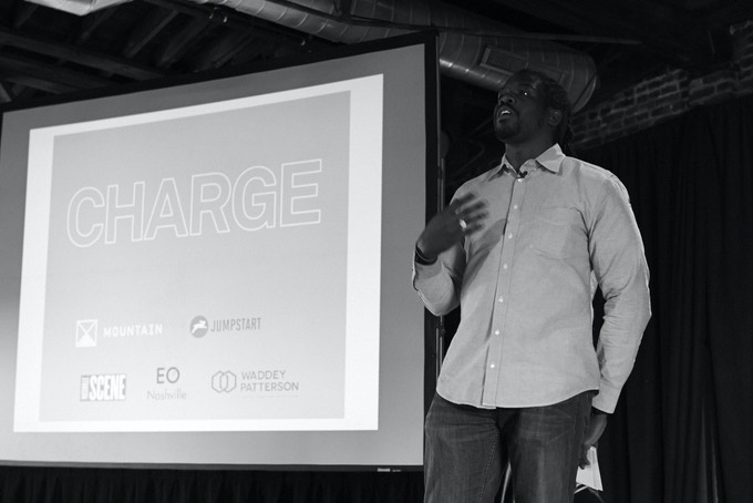 Me introducing a speaker at CHARGE in 2014