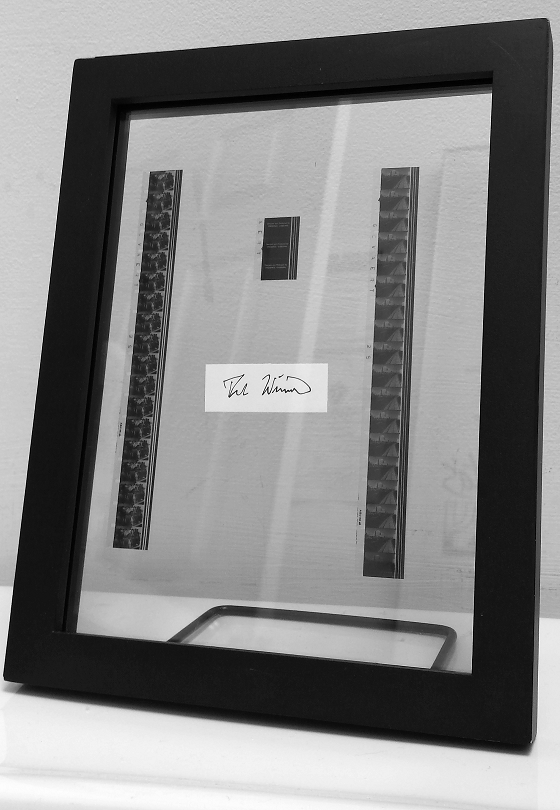 One of a kind mounted 16mm film frames with Fred's signature