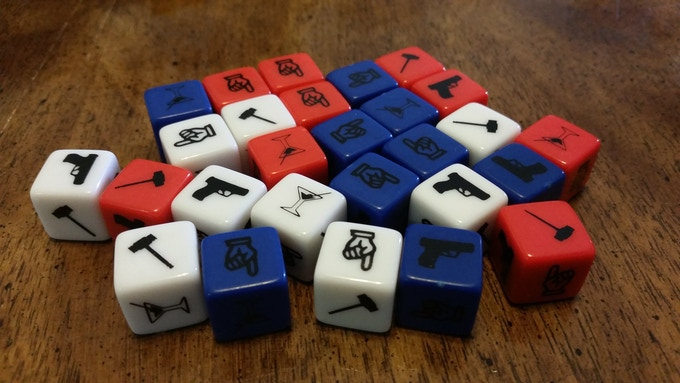 27 custom dice are included the game. The blue dice will have white ink in the production version, and all dice will be ENGRAVED!