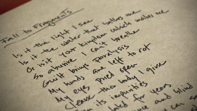 Handwritten lyrics on Japanese archival paper.