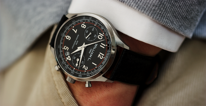 Vintage Chronograph Stainless Steel case with black leather strap on the wrist