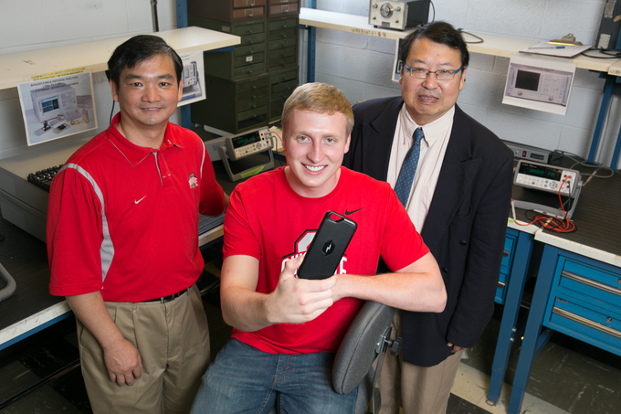 Dr. Chi Chih Chen, Dr. Rob Lee and Roland Tallos showcase the Nikola phone case for a local news outlet.