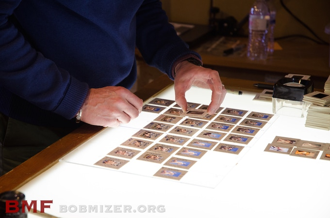Volunteers review each transparency and sort them by the order in which they were shot. They are then inserted into sleeves which are cataloged, photographed and placed into protected storage.