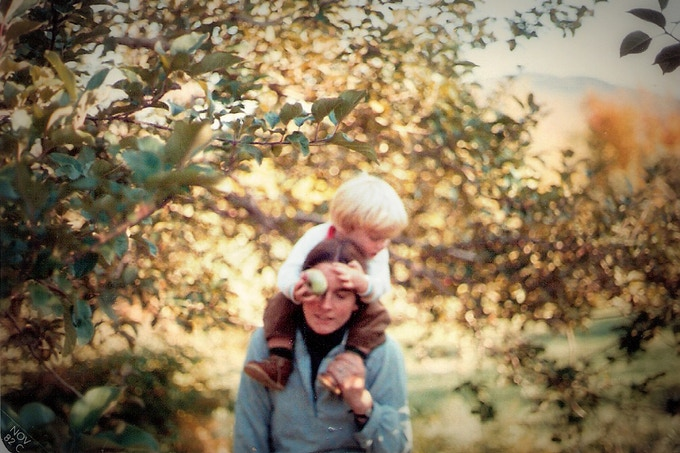 Young Galen strolls through an orchard with his mom.