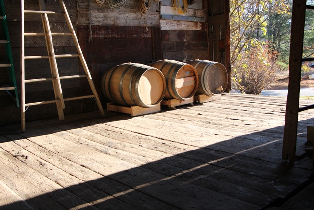 Oak barrels for fermenting and aging cider, housed in the barn, future site of the tasting room.