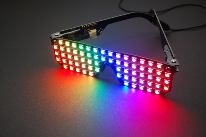 Wearable slotted shades with a bright full color pixel array you can see through! Incredible, hackable, and Arduino-compatible.