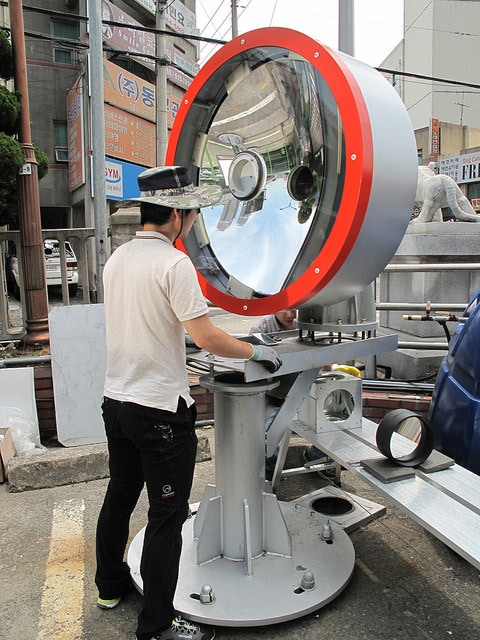 An engineer testing the solar device