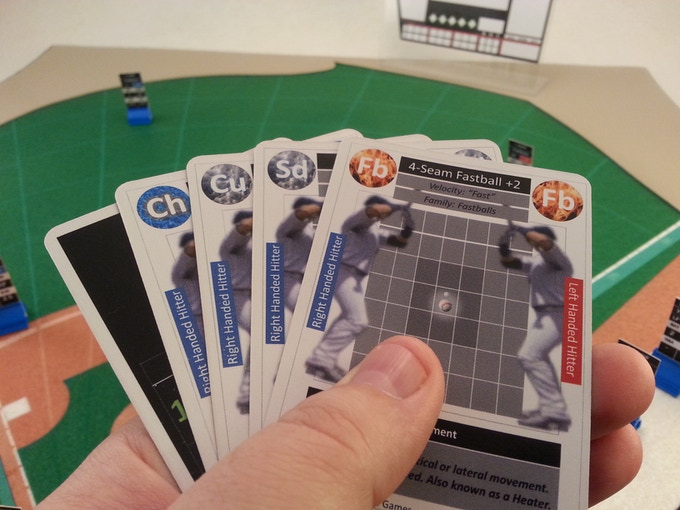 The Changeup, Curveball, Slider, and Fastball pitch cards shown in hand during a game