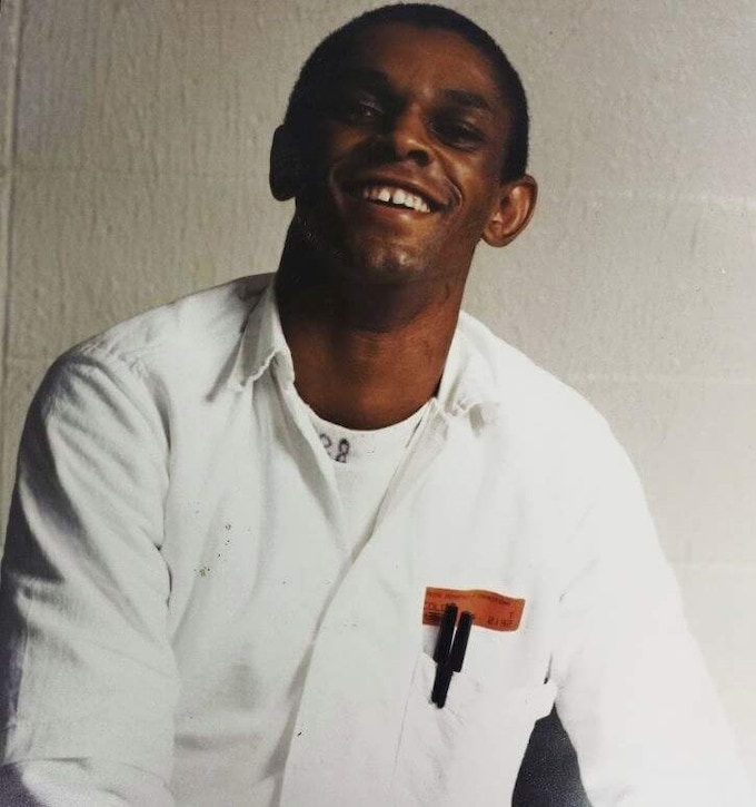 "One of the few existing photos of Tim in prison, still smiling his big smile despite all that had transpired.  On the back of the photo Tim's mother, Ruby wrote:  ""My first born. Always remember son, God is able. I love you, Mother"""