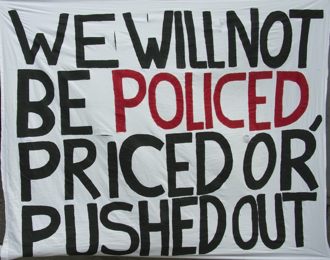 Banner at Ontario Coalition Against Poverty (OCAP) press conference condemning the Toronto police Anti-Violence Intervention Strategy (TAVIS)