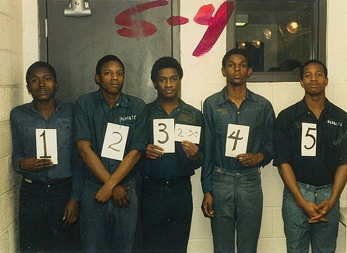 Tim in a Lubbock Police lineup. He's holding the no. 4 card.